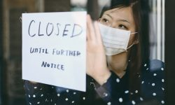 An Asian woman small business owner affected by the COVID-19 virus.